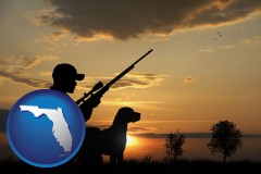 florida map icon and a hunter and a dog at sunset