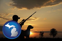 michigan map icon and a hunter and a dog at sunset