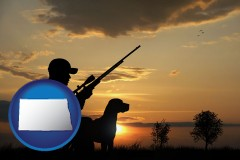 north-dakota map icon and a hunter and a dog at sunset