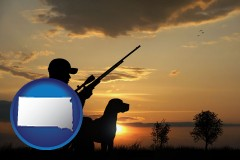 south-dakota map icon and a hunter and a dog at sunset