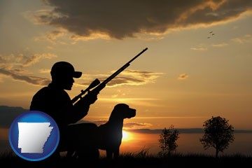 a hunter and a dog at sunset - with Arkansas icon