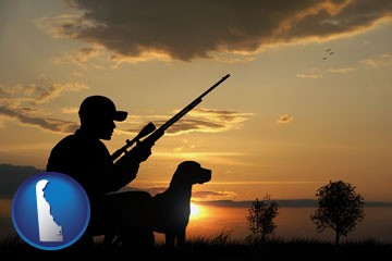 a hunter and a dog at sunset - with Delaware icon