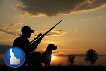 a hunter and a dog at sunset - with Idaho icon