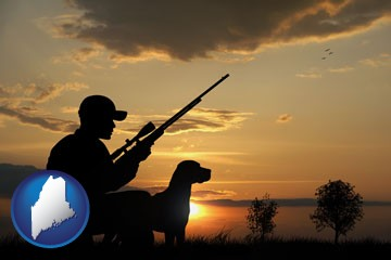 a hunter and a dog at sunset - with Maine icon