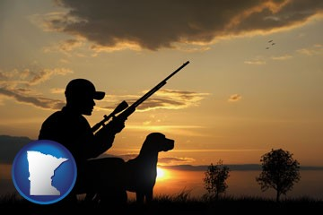 a hunter and a dog at sunset - with Minnesota icon