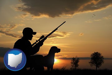 a hunter and a dog at sunset - with Ohio icon
