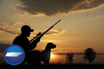a hunter and a dog at sunset - with Tennessee icon