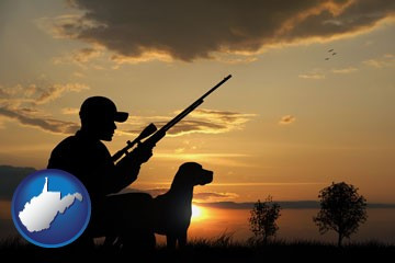 a hunter and a dog at sunset - with West Virginia icon